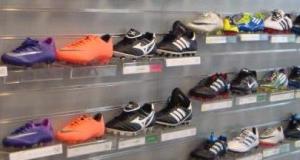 vinci scarpe da calcio con Western Union