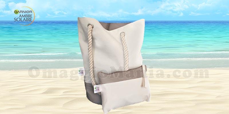 borsa mare e pochette Ambre Solaire